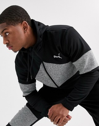 Puma Training Extract zip-up hoodie in black with quilted panels