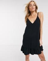 Asos Design DESIGN v front mini sundress with pep hem in black