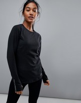New Balance In Transit Long Sleeve Top In Black