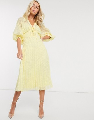 ASOS DESIGN pleated dobby midi dress with lace up front in yellow