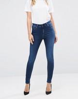 Asos Ridley High Waist Skinny Jeans in Minx Dark Stonewash Blue