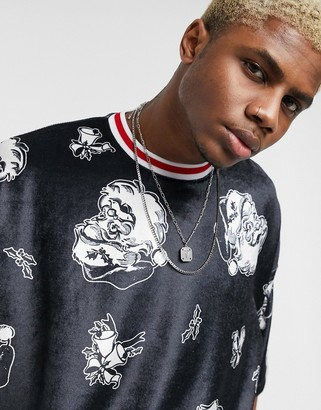 ASOS DESIGN Christmas oversized t-shirt with Santa Clause print in velour
