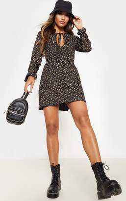 PrettyLittleThing Black Ditsy Floral Tie Front Flare Sleeve Shift Dress