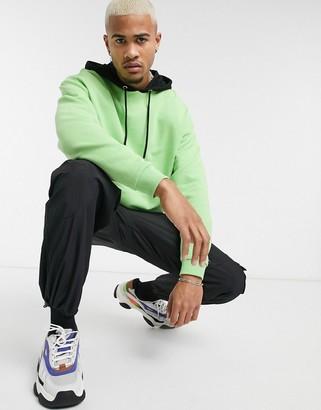 Asos Design DESIGN oversized hoodie in green with black hood