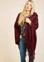 Fall in love with changing leaves, shifting seasons, and snuggly styles when this cozy shawl arrives at your doorstep. Composed of a super soft tan knit, and flaunting a heartwarming hood and fringed hemline, this chic layer is an ideal adornment for a fo
