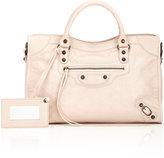 kim kardashian  Who made  Kim Kardashians tan suede skirt, pink suede pumps, and leather handbag?