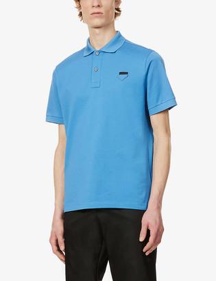 Prada Logo-badge classic-fit cotton-pique polo shirt