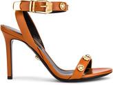 Versace Ankle Strap Heels in Orange | FWRD