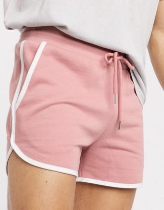 ASOS DESIGN jersey runner shorts in pink with white binding
