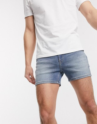 ASOS DESIGN skinny denim shorts in mid wash blue in shorter length