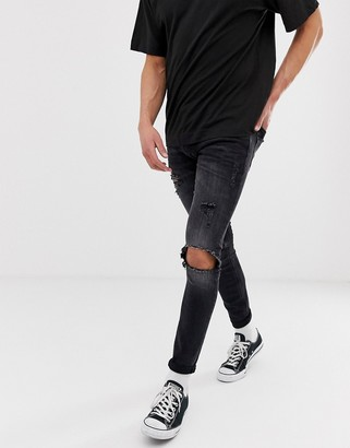 Jack and Jones Intelligence spray on skinny jeans with rip detail in washed black-Blue