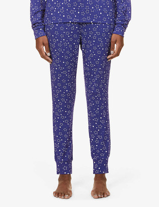 Stripe & Stare Star-pattern tapered stretch-jersey trousers