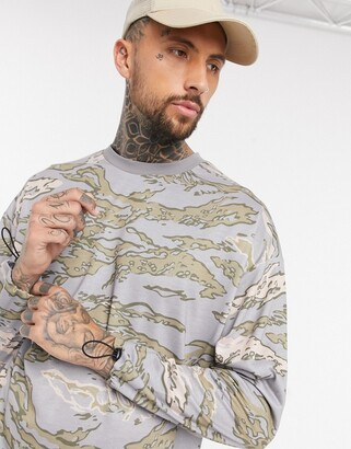 ASOS DESIGN oversized long sleeve t-shirt with all over camo marble print and cuff toggles in heavyweight jersey