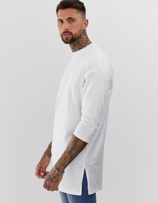 ASOS DESIGN oversized super longline t-shirt with 3/4 sleeve in white