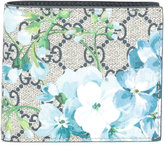 Gucci Blooms print GG Supreme wallet - men - Calf Leather - One Size