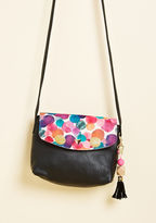 Pai Mini Bag In addition to having just enough space to stow your essentials for day or night, this black bag from Disaster Designs touts plenty of smiles to spare! A confetti of multicolored dots details the flop of this pretty mini purse, while a removable geometric
