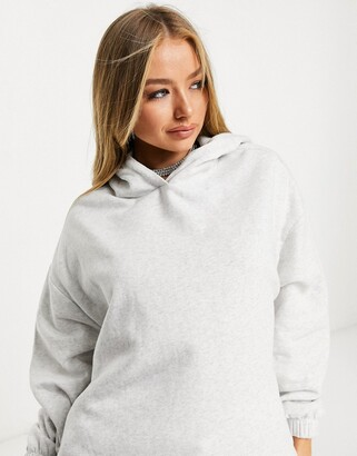 ASOS DESIGN super oversized cocoon hoodie with side pockets in white marl
