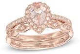 Zales Precious BrideTM Pear-Shaped Morganite and 1/4 CT. T.W. Diamond Frame Vintage-Style Bridal Set in 14K Rose Gold