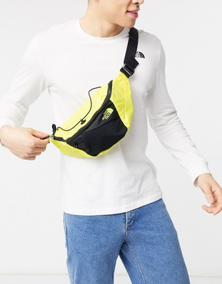 The North Face Lumbnical small bum bag in yellow