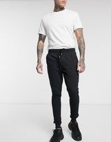 Asos Design DESIGN organic super skinny joggers in black