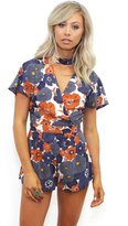 West Coast Wardrobe Light of Night Floral Romper in Navy/Rust