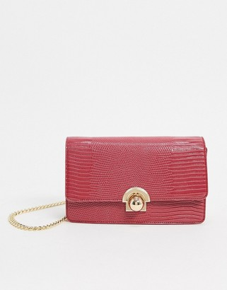 ASOS DESIGN cross body bag in burgandy lizard with ball hardware
