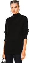 R 13 Distressed Edge Cashmere Turtleneck Sweater in Black.