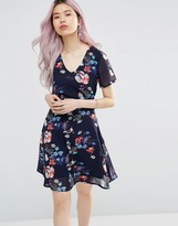 Yumi Tea Dress In Floral Lace Tie Back Dress