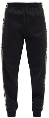 Vetements Logo-striped Cotton-blend Jersey Track Pants - Black