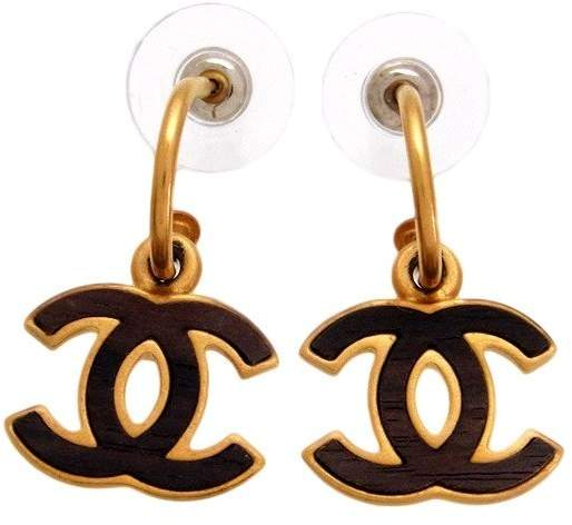 Chanel Gold Tone Metal Wood CC Logo Dangle Stud Earrings
