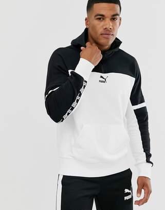 Puma XTG half-zip hoodie in black / white