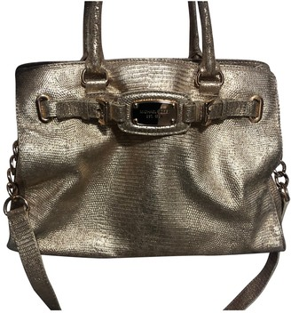 Michael Kors Gold Leather Handbags