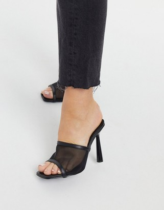 Truffle Collection stiletto heeled mules with high vamp in black
