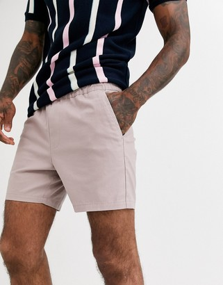 ASOS DESIGN skinny shorter chino shorts with elastic waist in warm pink