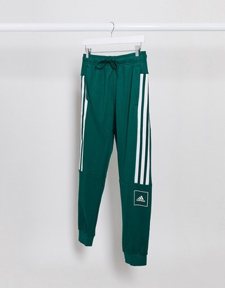 adidas Training skinny fit 3 stripe joggers in green