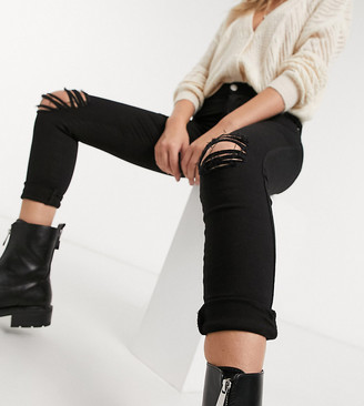 Dr Denim Petite Lexy mid rise super skinny jeans with ripped knees in black