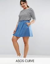 Asos Denim Button Front Mini Skater Skirt In Mid Wash Blue