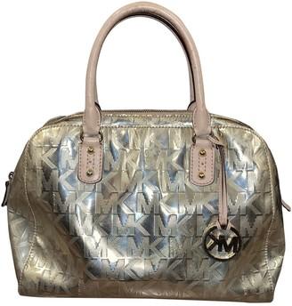 Michael Kors Gold Plastic Handbags