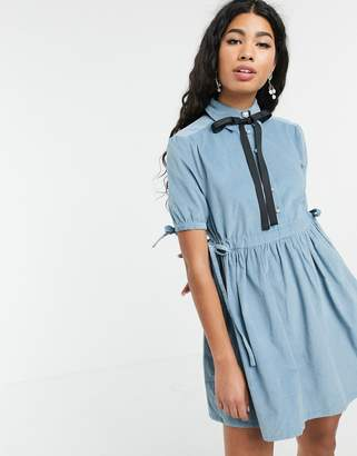 Sister Jane mini smock dress with tie sides and pussybow in baby cord-Blue