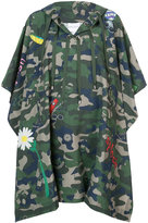 Mira Mikati camouflage cape with graphics