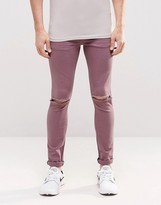 Asos Super Skinny Jeans With Knee Rips In Purple