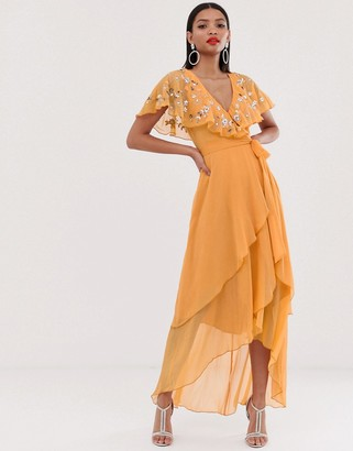 Asos Design DESIGN maxi dress with cape back and dipped hem in embellishment-Orange
