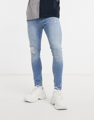 ASOS DESIGN spray on jeans with power stretch in light wash with abrasions