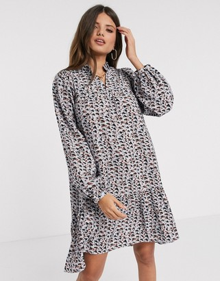 Vero Moda tiered smock dress with volume sleeve in blue abstract print