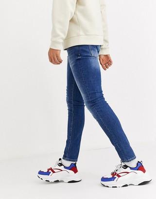 Mennace skinny jeans in mid blue wash