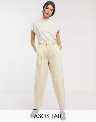 Asos Tall DESIGN Tall Tapered boyfriend jeans with D-ring waist detail with curved seams in washed lemon