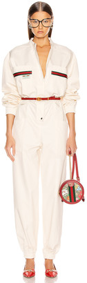 Gucci Long Sleeve Jumpsuit in Ivory & Multicolor   FWRD