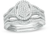 Zales 1/3 CT. T.W. Composite Diamond Oval Frame Bridal Set in 10K White Gold
