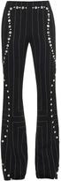 Edun Button-detail pinstripe trousers