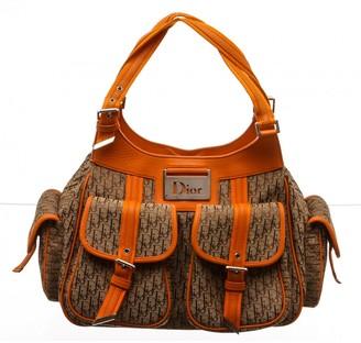 Christian Dior Orange Cloth Handbags